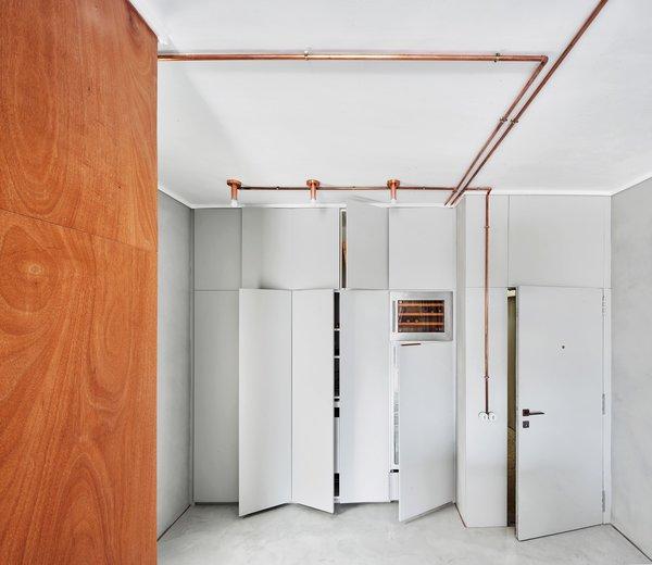 Entrance along with built in closets, fridge & vinotecca