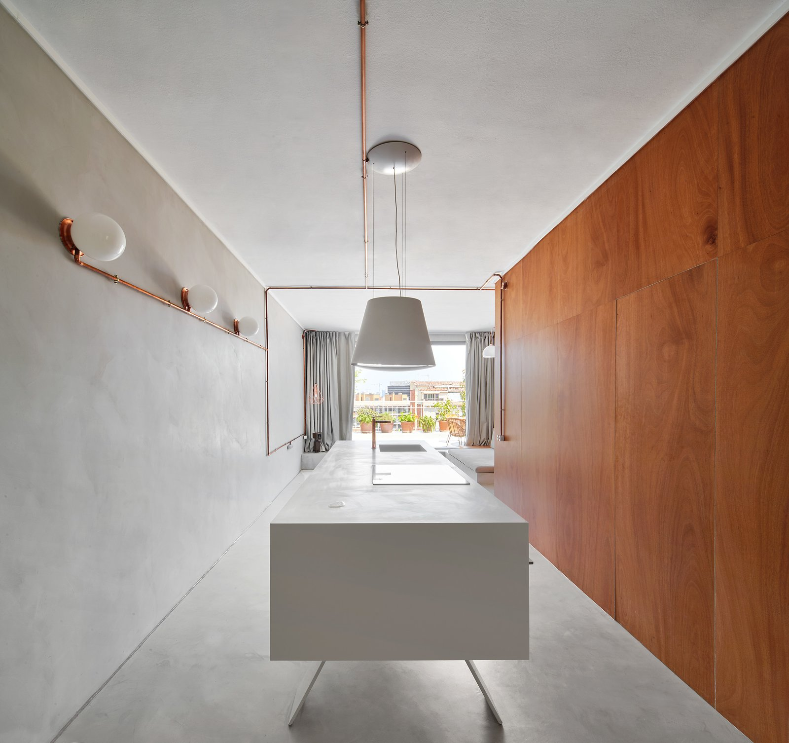 Kitchen, Wall, Refrigerator, Ceiling, White, Concrete, Drop In, and Engineered Quartz Kitchen volume along  Laundry/ WC wooden volume  Kitchen Concrete Refrigerator Wall Photos from The Marina Apartment