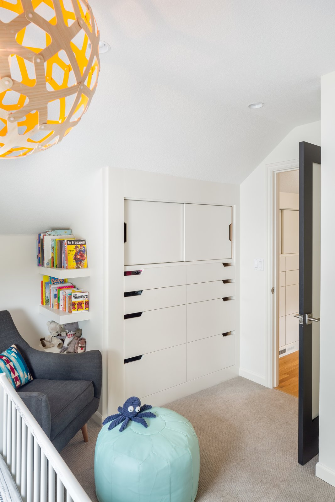 Wood Counter, Ceramic Tile Floor, Drop In Sink, Wall Lighting, and Kids Room Fun shapes make for the perfect Scandinavian modern nursery   Hurst Avenue by Guggenheim Architecture + Design Studio