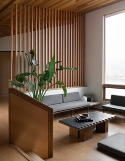 The sunken living room allows for delineation of space while keeping an open-plan environment