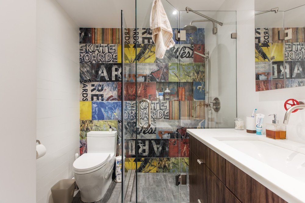 """In the bathroom, they planned to change the footprint to allow for a larger, more accessible layout, and customize the adjoining closet to cater to """"his and her"""" needs. The footprint was rotated 90 degrees to swap the shower and vanity, allowing for greater use of space overall.  Gramercy Studio Renovation"""