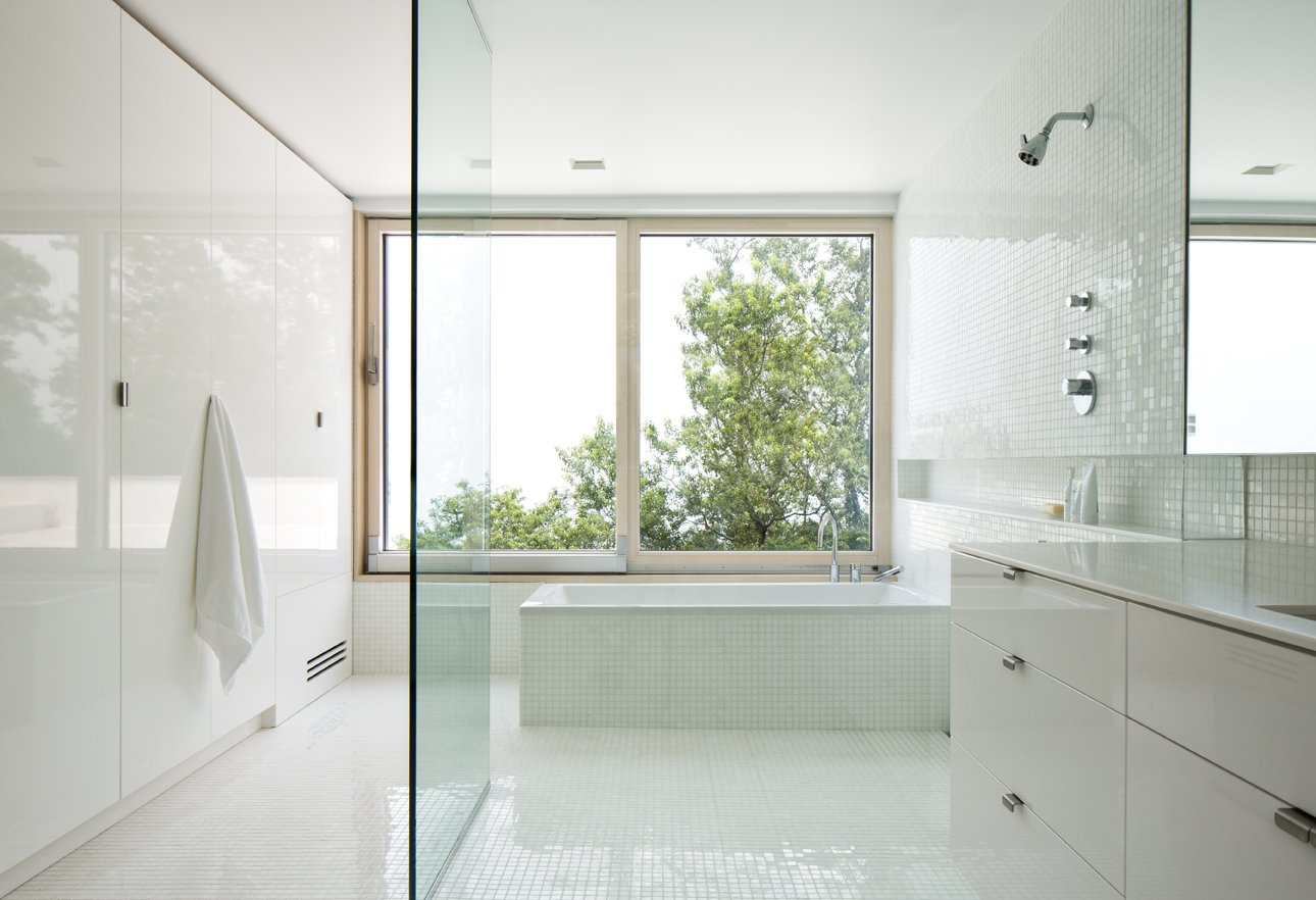 Bath Room, Ceramic Tile Wall, Engineered Quartz Counter, Ceramic Tile Floor, Freestanding Tub, and Open Shower Master Bath  Orient House IV by Ryall Sheridan Architects