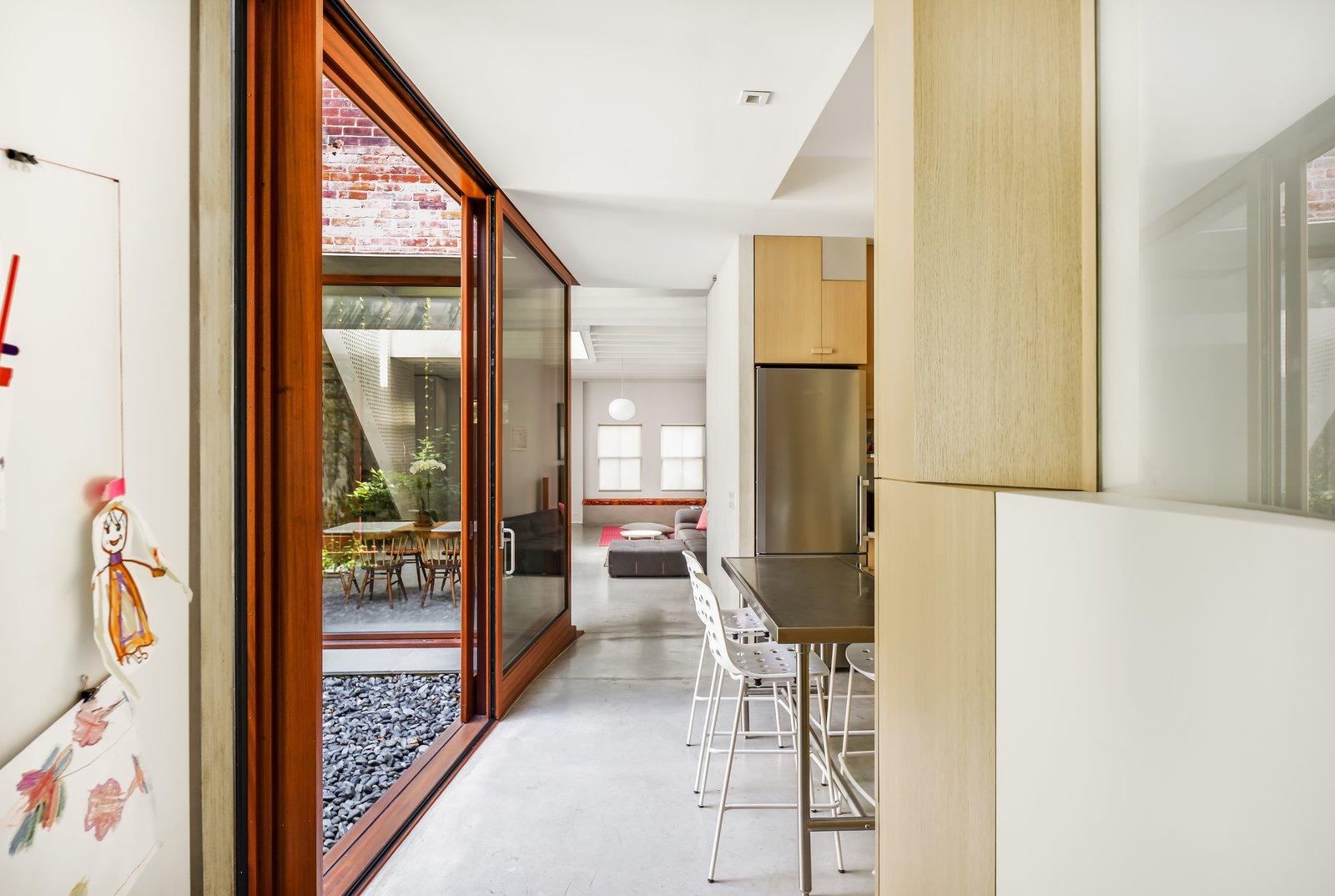 Outdoor, Garden, and Hardscapes Kitchen opening to Garden  Best Photos from Brooklyn Carriage House
