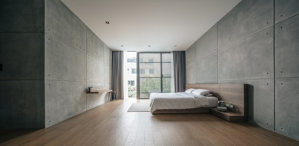 Recessed lighting is strategically placed along the edges of this expansive, minimalist bedroom in Thailand. For master bedroom ceiling lighting ideas where a clean look is desired, recessed lighting makes a great option.