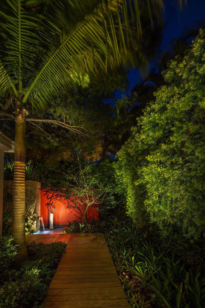 Even small gardens can have a big impact with the right design, tall palms lead your eyes upwards creating even more space in a small area while bold features at the end of a path accentuates the long view of the garden.  Von Phister by Craig Reynolds Landscape Architecture