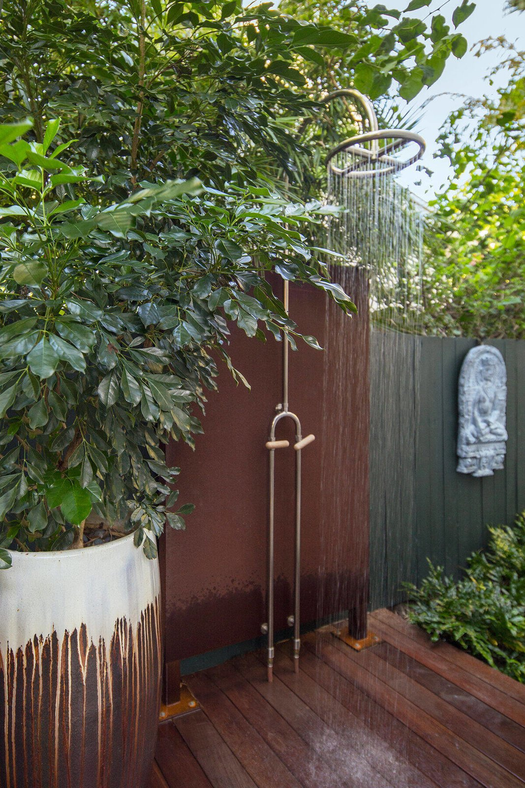 Outdoor, Garden, Side Yard, Gardens, Walkways, Hardscapes, Wood Patio, Porch, Deck, Shrubs, Decking Patio, Porch, Deck, and Landscape Lighting An outdoor shower was placed near the pool but tucked away to allow some privacy for those using it.  Von Phister by Craig Reynolds Landscape Architecture