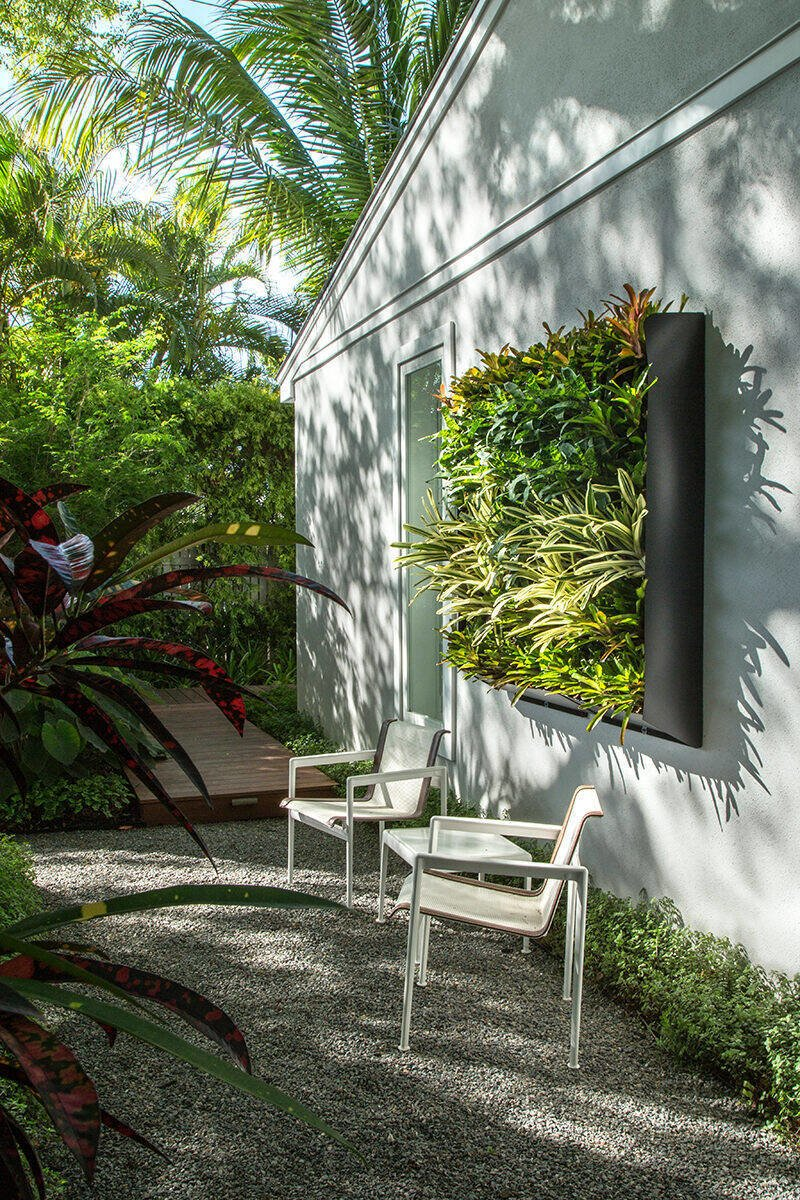 Outdoor, Back Yard, Garden, Hardscapes, Gardens, Walkways, Trees, Landscape Lighting, Wood Patio, Porch, Deck, and Decking Patio, Porch, Deck A living wall was designed to create interest on an otherwise blank wall making the small seating area more inviting.  Von Phister by Craig Reynolds Landscape Architecture