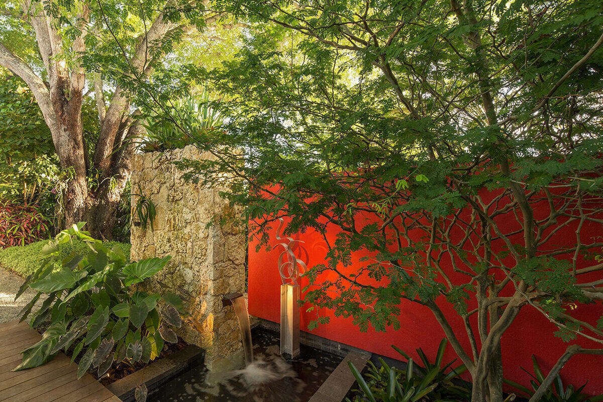 A fountain should always look good, even when dry. The bold red wall next to the natural stone veneer wall creates an interesting juxtaposition while a sculptural airy tree adds further interest while still maintaining the ability to see through it.  Von Phister by Craig Reynolds Landscape Architecture