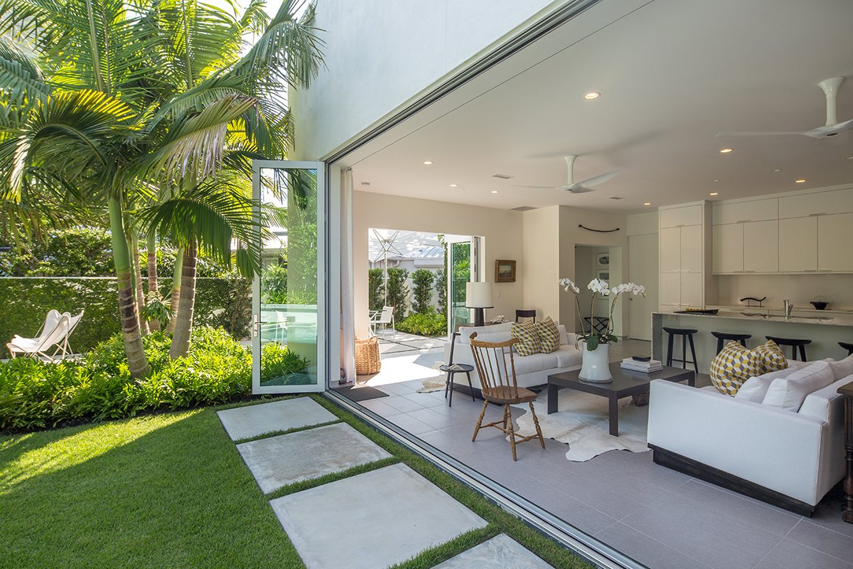 Outdoor, Back Yard, Trees, Side Yard, Shrubs, Grass, Garden, Hardscapes, Small Patio, Porch, Deck, Landscape Lighting, Walkways, and Concrete Patio, Porch, Deck Indoor/outdoor living in 'key' here in the Florida Keys.  Tropical Minimal by Craig Reynolds Landscape Architecture