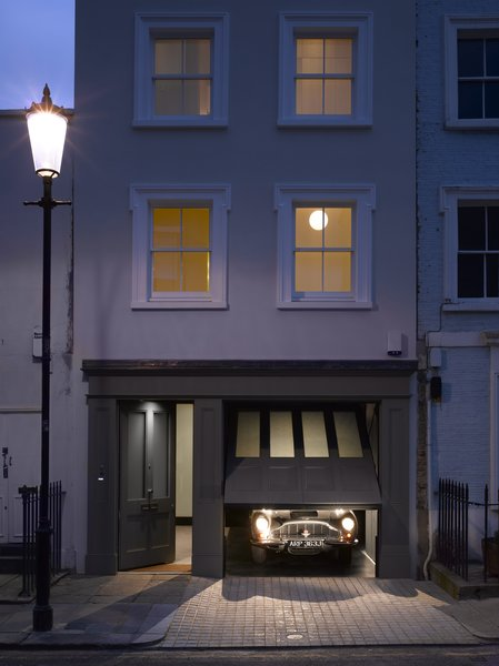 In a conservation district in London, this historic home got a modern interior behind its original facade. The renovation included a new paneled garage door that follows the style and proportion of the main door, with four glazed panels above four lower recessed panels.