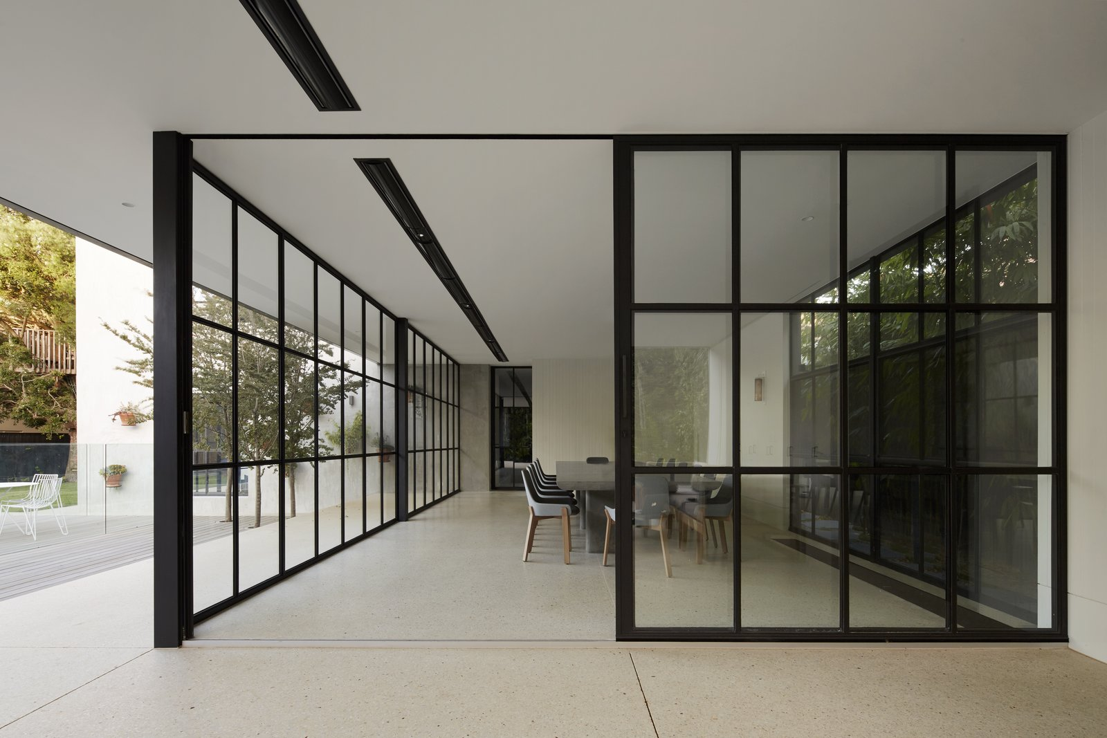 Dining Room, Chair, Recessed Lighting, Table, Track Lighting, and Terrazzo Floor In their approach to renovating and adding an extension to Hopetoun Road Residence, B.E. Architecture sought to first  Photo 1 of 11 in See How Sliding-Glass Pavilions Transformed a Renovated Melbourne Home from 50 Modern Homes With Floor-to-Ceiling Windows
