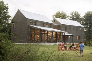 A Kennebunk family needed their forever home, and the old farmhouse and barn that stood on their property wasn't going to cut it. The architects at Caleb Johnson Studio started the process by salvaging everything they could from the old buildings, including the timber roof structure, interior wood cladding, and interior doors. Additionally, the architects also claimed cabinetry and fixtures from a midcentury home that was being torn down in Weston, Massachusetts. By incorporating such materials into the new home's design, they were able to create a modern farmhouse with soul.
