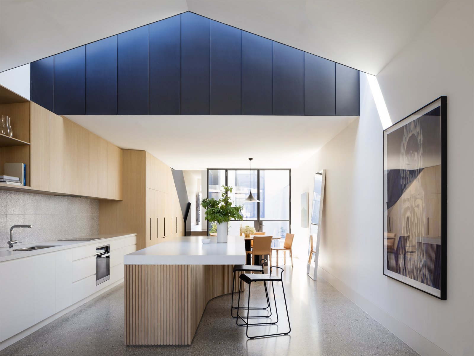 Kitchen, Wood Cabinet, Undermount Sink, Wall Oven, and Pendant Lighting The firm then combined a palette of steel, concrete, and oak in the elegant, double-height rear addition.   Photo 3 of 10 in Dwell's Top 10 Kitchens of 2017 from Soak In the Greatness of This Gorgeous Melbourne Addition