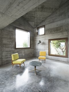 An Italian architecture studio offers an updated take on the vacation cabin. It's an ideal setting for a getaway: rolling hills dotted with villages and castles in Italy's Oltre Po Pavese region. A young Milanese couple wanted a small vacation home on their 3000-square-meter lot there—and 35a Studio delivered, by way of this 120-square-meter cabin decked out in textural concrete and strategically accented with wood.
