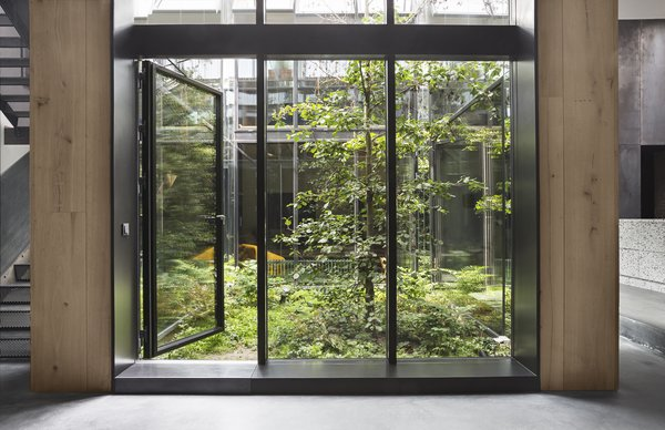 A few years ago, photographer Peter Krasilnikoff asked Studio David Thulstrup to create his new Copenhagen home from an old pencil factory and incorporate a green space. Taking inspiration from urban rooftop gardens and