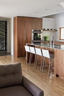 """""""Sometimes this means considering what is hidden away as much as what's visible,"""" he adds. """"With counter space at a premium, valuable space can be saved by designating an enclosed area to tuck away those space-sucking counter-top appliances and gadgets."""""""