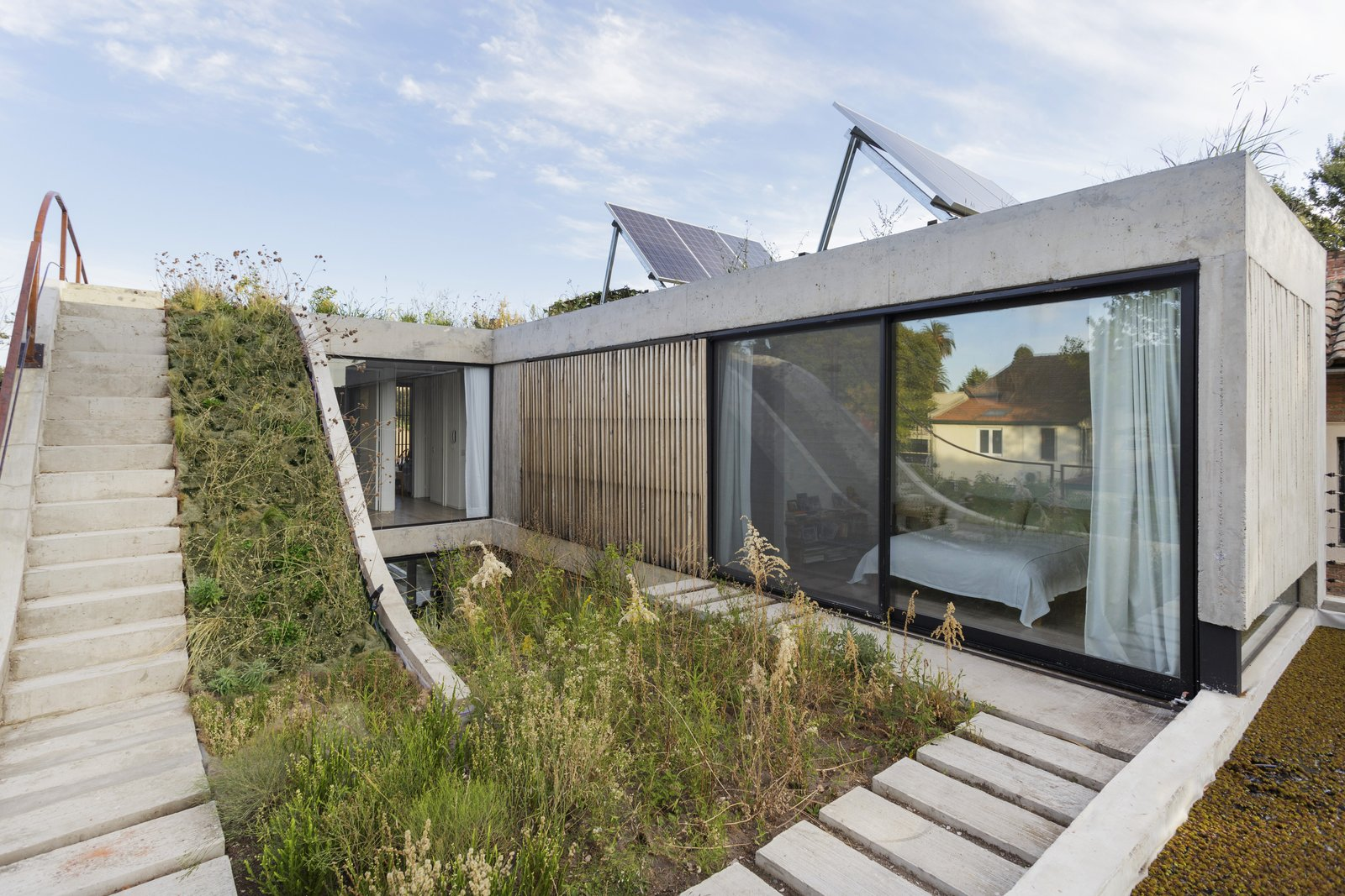 Outdoor, Rooftop, Hardscapes, Walkways, Concrete Patio, Porch, Deck, Gardens, Shrubs, and Garden The first floor with bedrooms overlooking rooftop gardens.  Photos from A Gardener's Home in Argentina Boasts Flowing Green Spaces