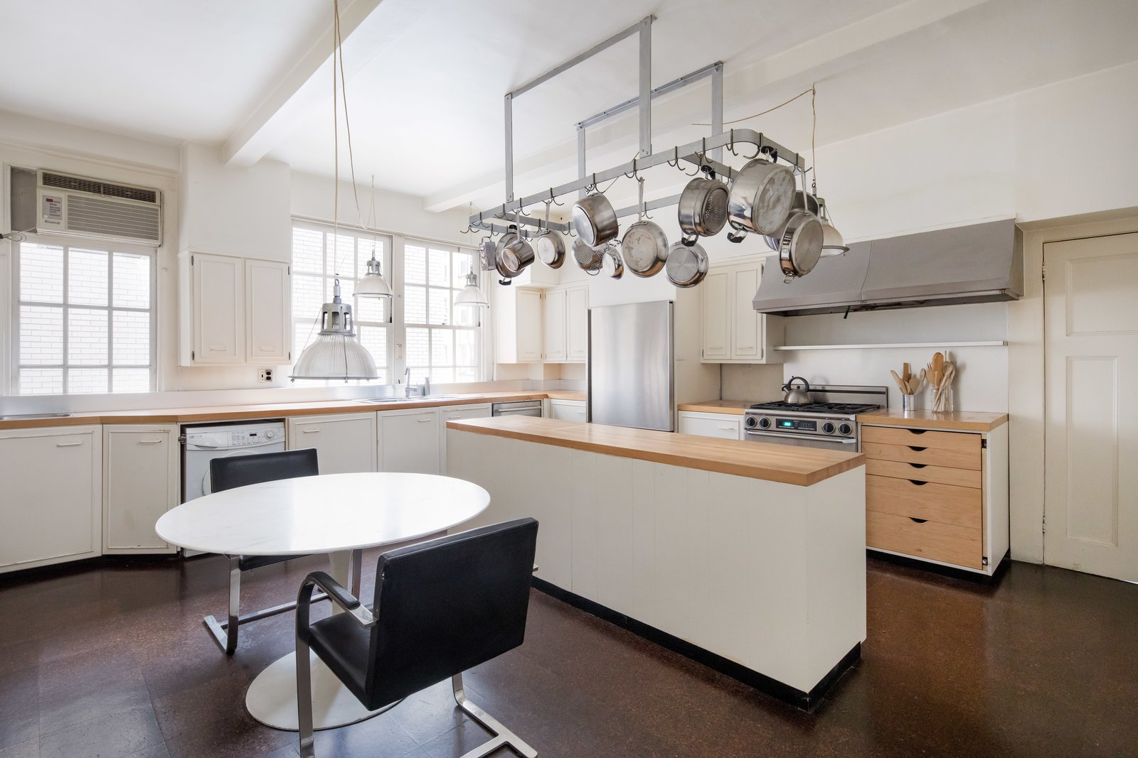 Kitchen, Wood, Refrigerator, Pendant, Dishwasher, Range Hood, Wood, Drop In, White, and Range The eat-in kitchen with butcher block counters.  Best Kitchen Range White Dishwasher Pendant Wood Photos from Legendary Designers Massimo and Lella Vignelli's New York Duplex Is Listed at $6.5M