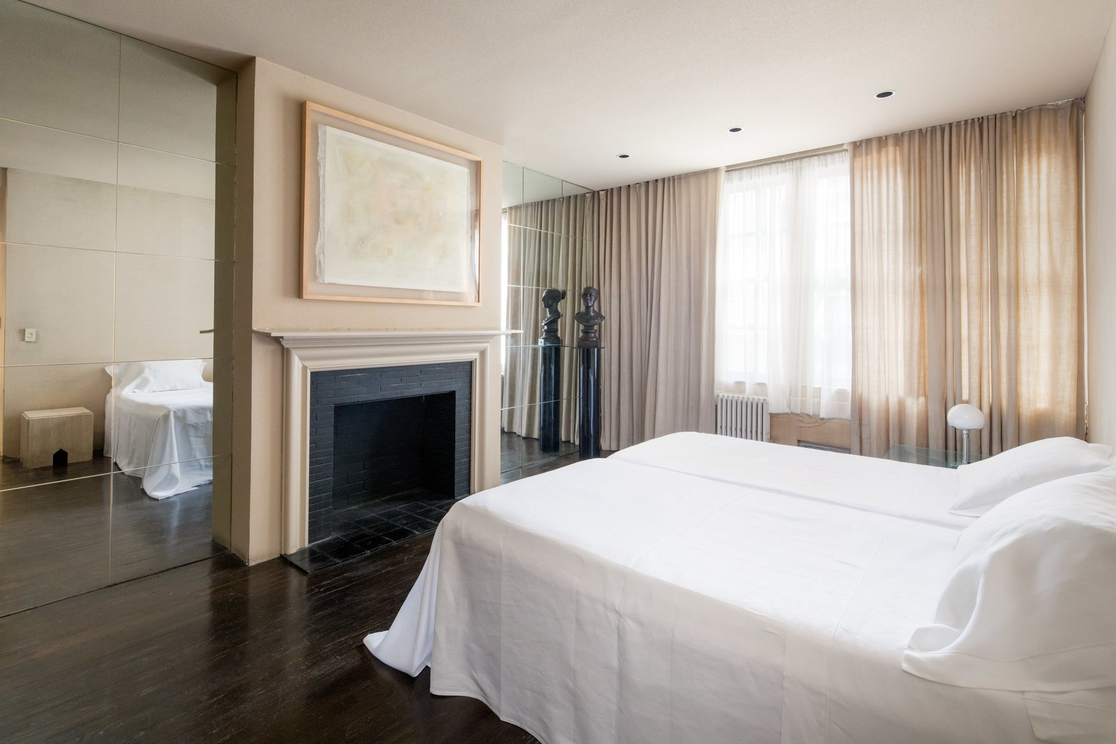 Bedroom, Bed, Dark Hardwood, Table, Recessed, Lamps, and Night Stands Each of the three bedrooms has an en-suite bathroom.  Best Bedroom Lamps Dark Hardwood Photos from Legendary Designers Massimo and Lella Vignelli's New York Duplex Is Listed at $6.5M