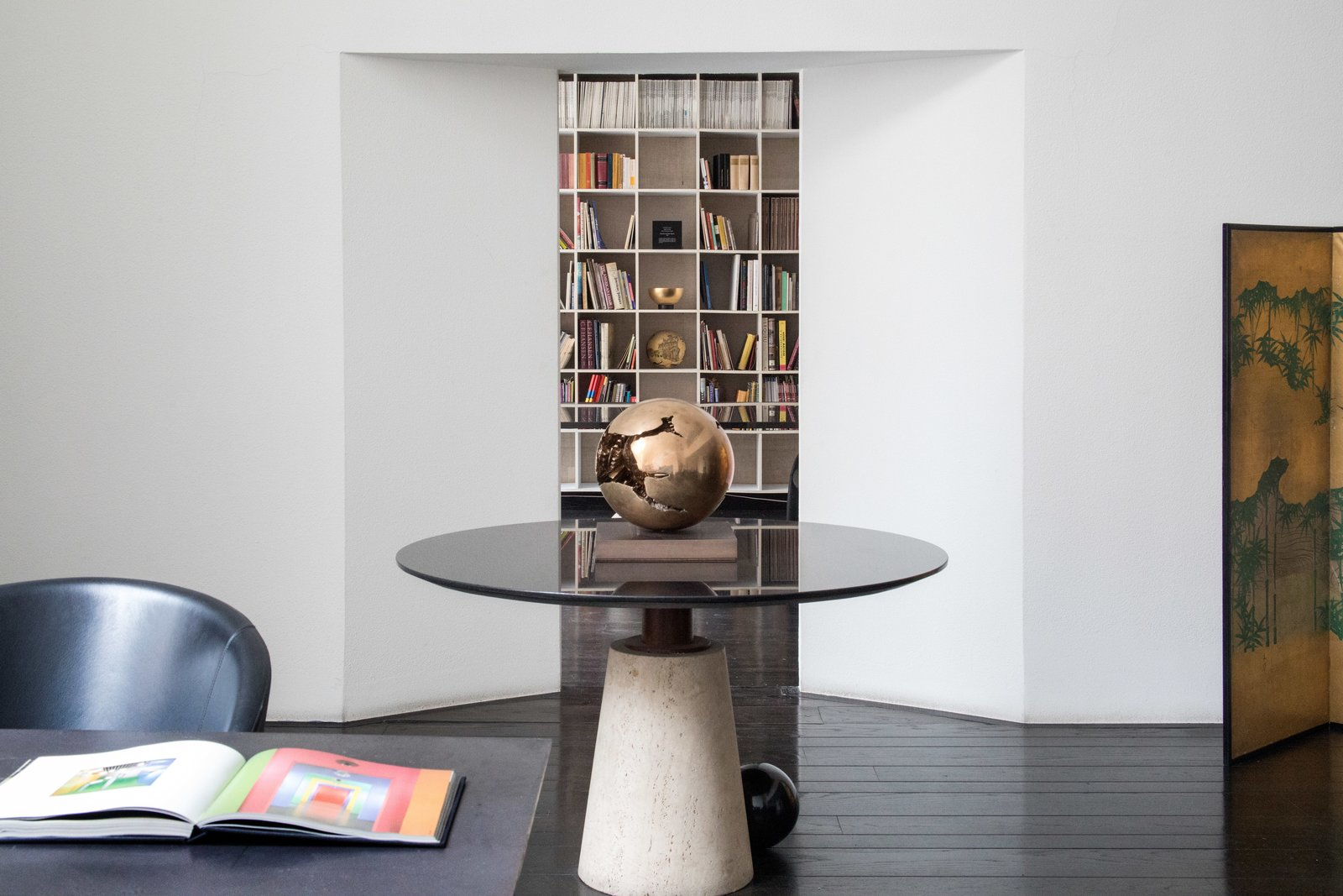 Office, Chair, Library, Dark Hardwood, Shelves, Desk, and Bookcase Their offices were side-by-side. His in the living room and hers adjacent, making for easy collaboration.  Office Dark Hardwood Library Bookcase Photos from Legendary Designers Massimo and Lella Vignelli's New York Duplex Is Listed at $6.5M