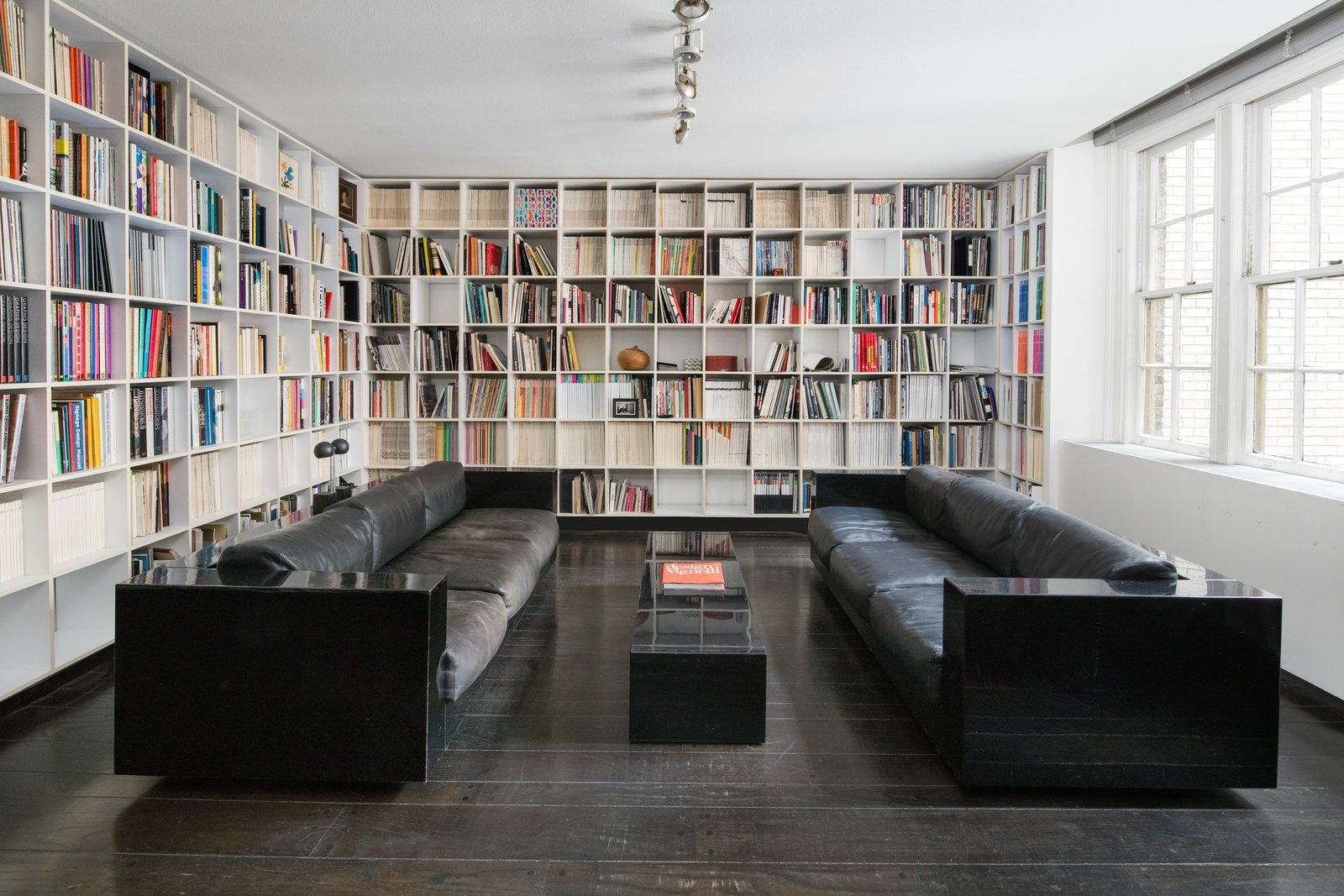 Office, Bookcase, Dark Hardwood Floor, Shelves, Library Room Type, and Study Room Type A dining room that was converted to a library.  Photos from Legendary Designers Massimo and Lella Vignelli's New York Duplex Is Listed at $6.5M