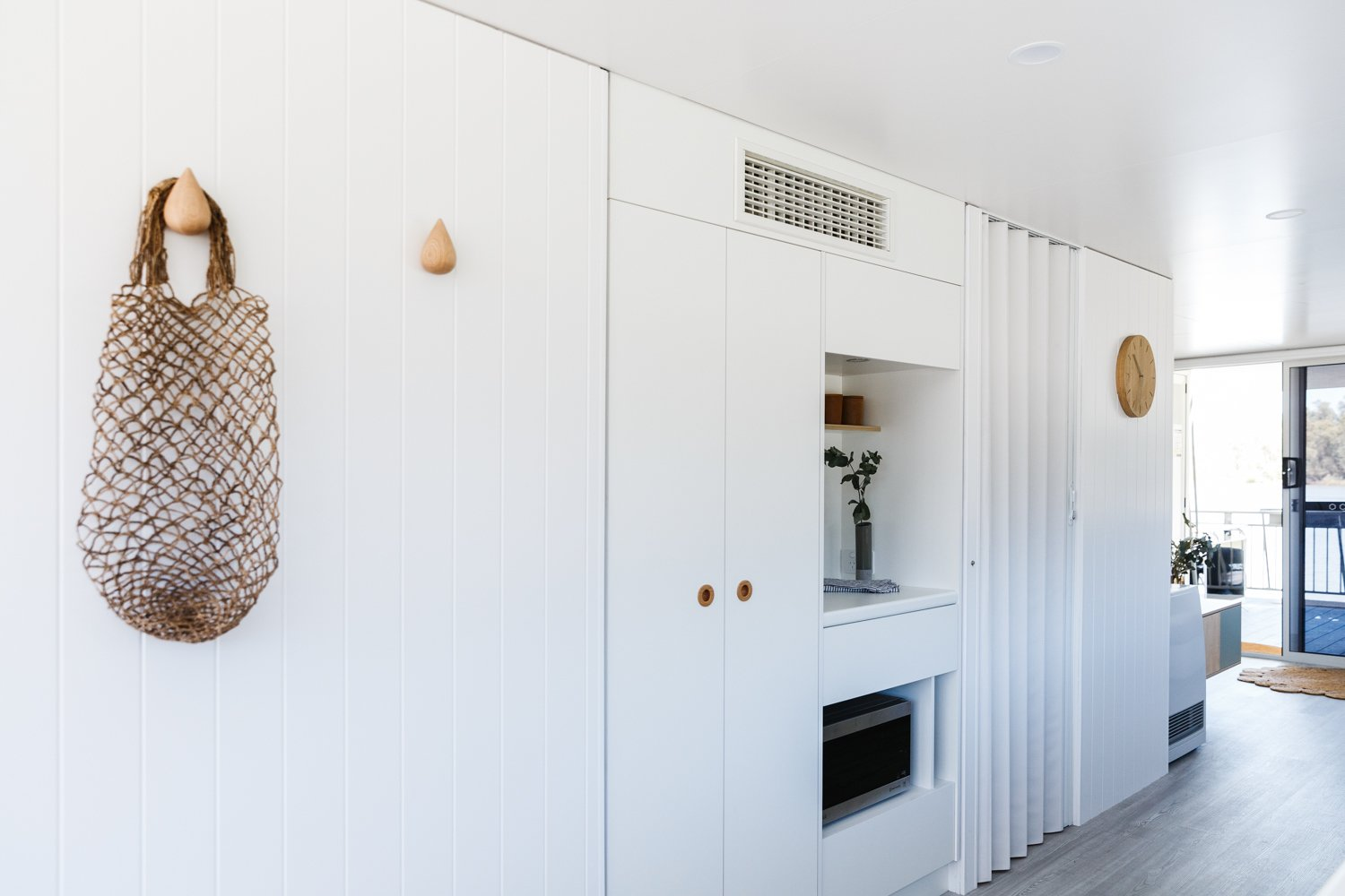 Storage Room and Cabinet Storage Type Australian paint by Haymes envelopes the interior, including vertical and built-in storage.  Photo 5 of 14 in Life in This Renovated Houseboat Would Be But a Dream
