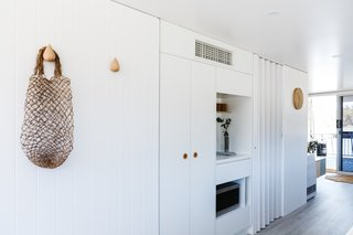 Australian paint by Haymes envelopes the interior, including vertical and built-in storage.