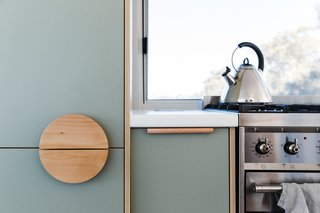 "Harry said: ""The inclusion of Australian product in this design was integral given its context."" Kitchen joinery in affordable soft sage laminate sports the leather recessed pull from Made Measure and  timber door hardware from In-Teria."