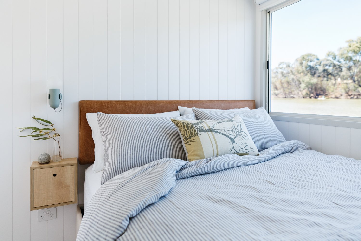 Bedroom, Bed, Storage, Wall Lighting, and Night Stands Bedrooms capitalize on river views and built-in storage.  Photo 12 of 14 in Life in This Renovated Houseboat Would Be But a Dream