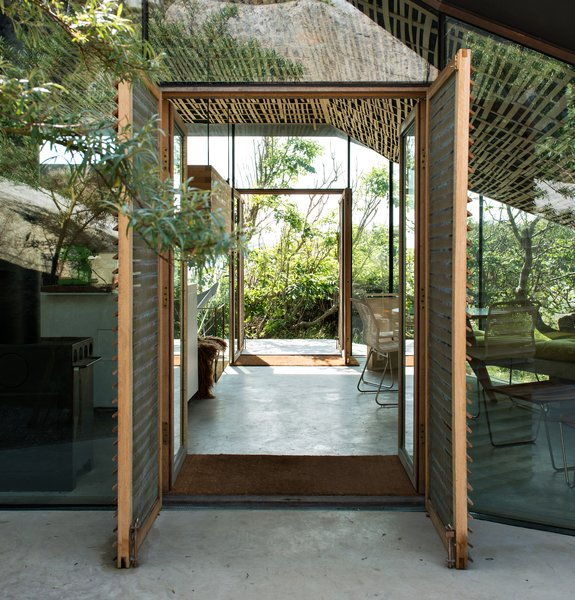 """Views from the main living area focus on the surrounding vegetation. """"Instead of placing the house on the spot with the best view, it is situated in a way that is tailored to the specific terrain, and gives prominence to the views from the outdoor room,"""" write Lung Hagem Arkitekter."""