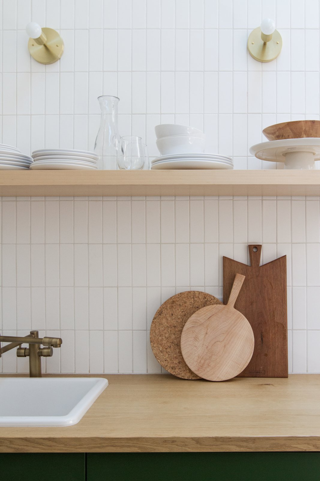 Kitchen, Wood, Drop In, Ceramic Tile, Colorful, Open, and Wall The floating shelf is from Semihandmade, faucet from Homary, and sconces from Cedar & Moss.  Best Kitchen Ceramic Tile Wall Photos from A Chic, Renovated A-Frame in Palm Springs Asks $535K