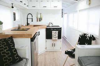 For the L-shaped kitchen, the Mayes' chose an under-counter fridge/freezer unit so as to have more counter space. The 23-inch Vigo sink is deep enough to bathe a baby or hide dirty dishes.