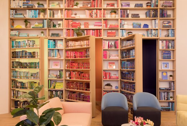 Secret doors in the bookcases conceal soundproof phone booths.