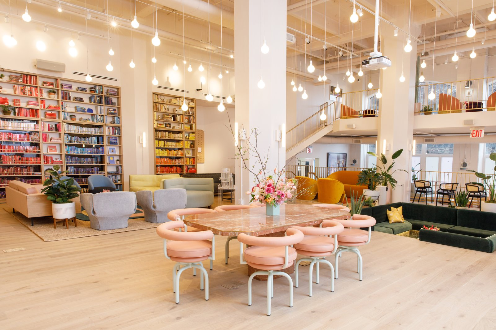 Office, Chair, Bookcase, Library Room Type, Study Room Type, Light Hardwood Floor, Shelves, and Rug Floor A dramatic pink granite table provides a central meeting spot.  Photo 11 of 11 in 10 Dwell Projects That Were Proudly Designed by Women