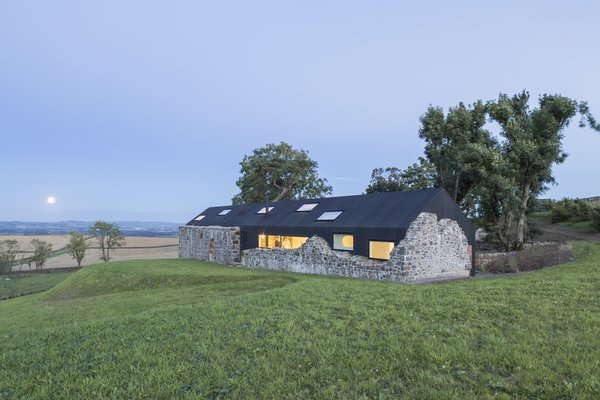 The crumbling stone walls of a 17th-century farmhouse in the remote countryside of Dumfries, Scotland, presented a unique renovation opportunity for Lily Jencks Studio and Nathanael Dorent Architecture, the teams behind this project. Rather than demolish the old walls, they inserted a crisp, modern home within them, so as to emphasize the site's history and passage of time.