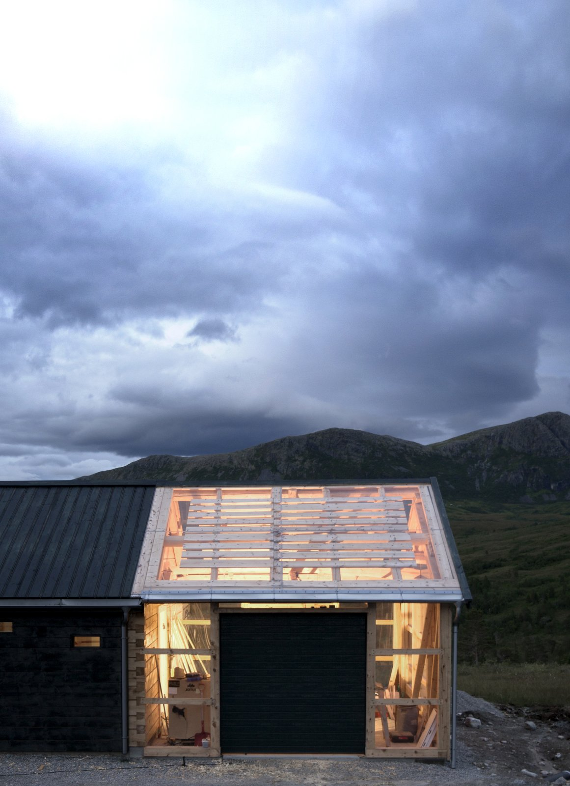 Garage, Attached Garage, Sun Room, and Storage On nice days, doors can be opened for indoor/outdoor flow.  Best Garage Sun Room Photos from This Astounding Cabin in Norway Is a Patchwork of Different Materials