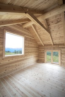 In the fourth section of the cabin, there's a large North-facing window for observing northern lights.