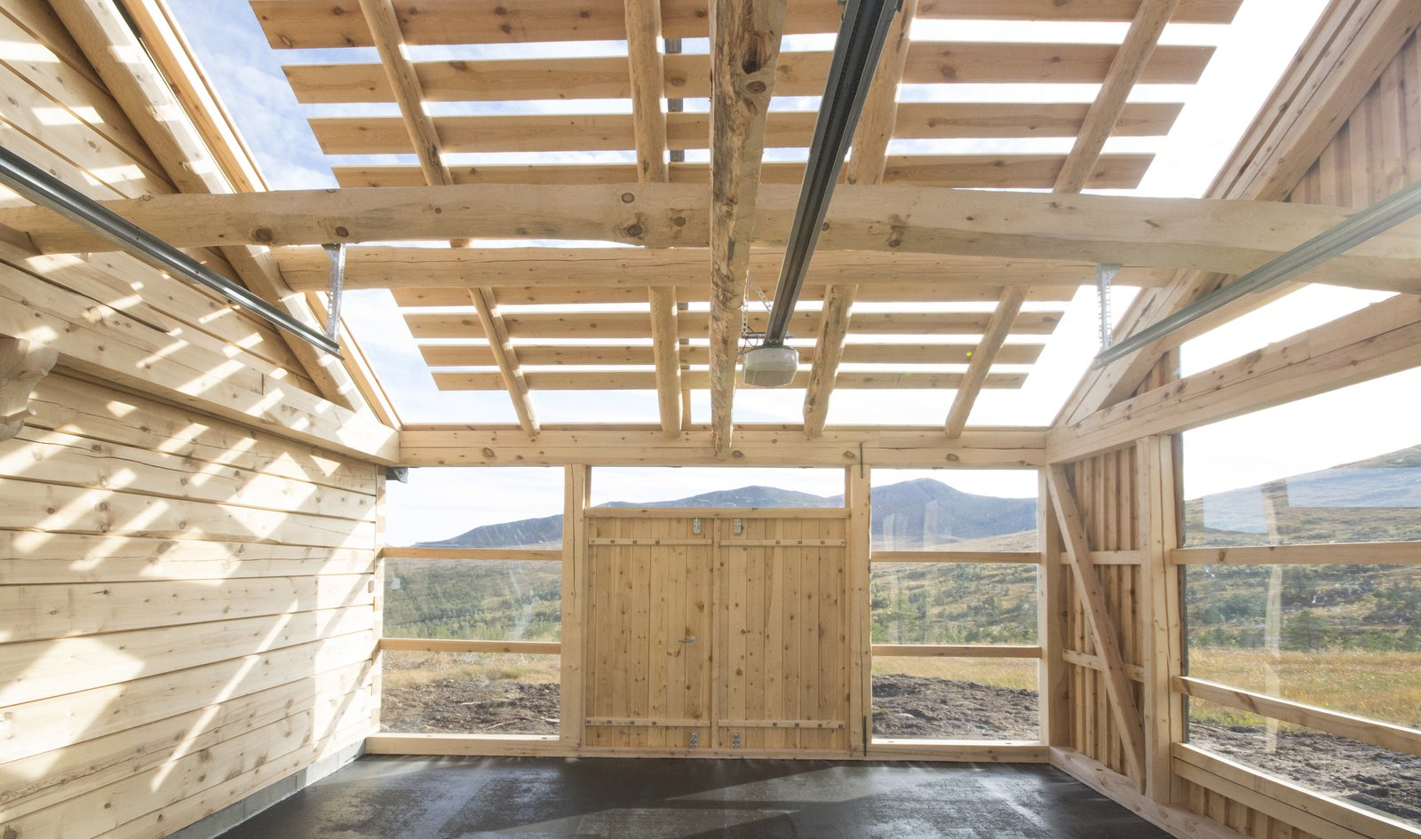 Garage, Storage Room Type, Attached Garage Room Type, and Sun Room Room Type The garage can also be used as a fitness/workout room, workshop and conservatory.  Photo 4 of 8 in This Astounding Cabin in Norway Is a Patchwork of Different Materials