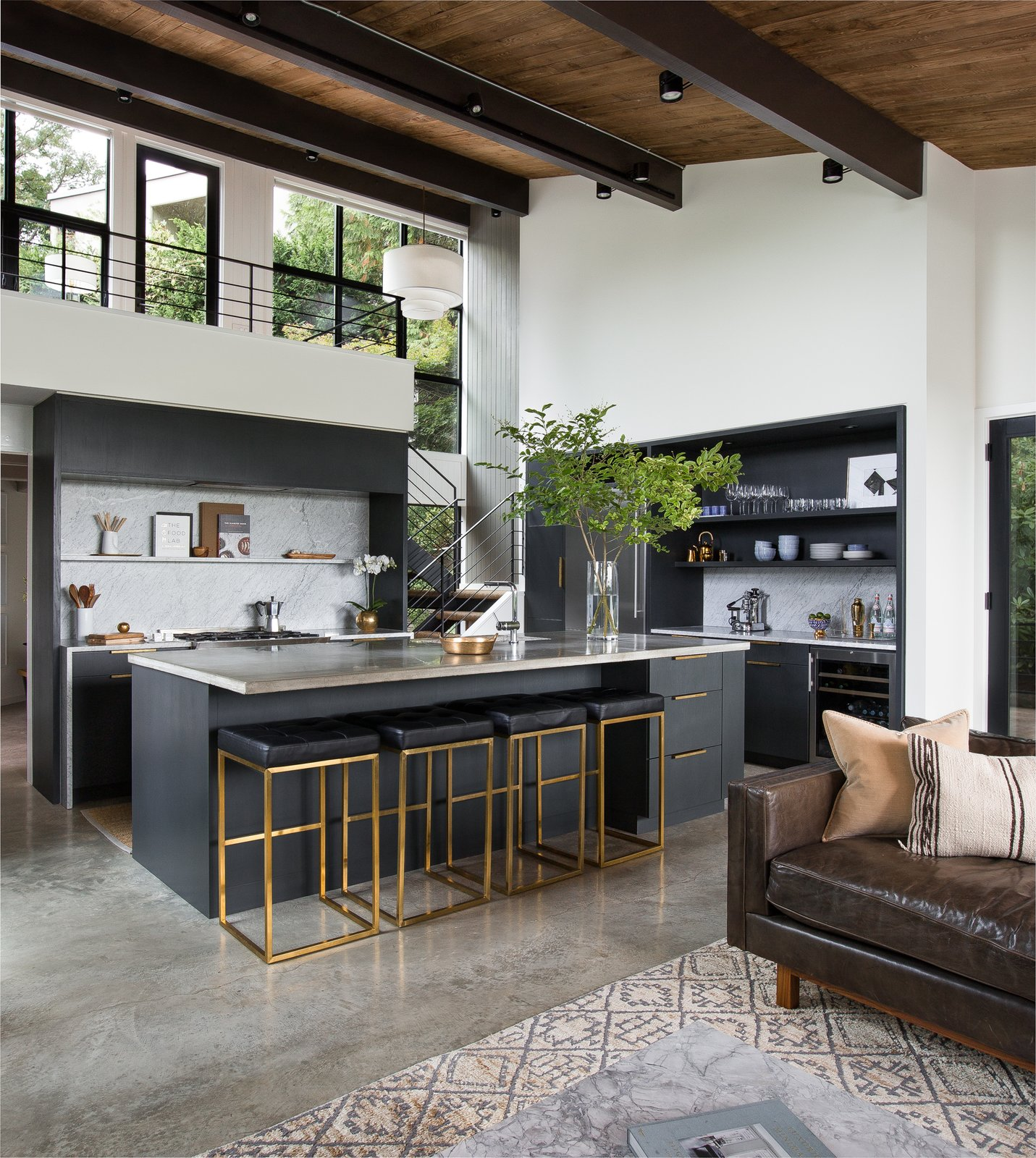 Montlake House kitchen with island bar and concrete floors