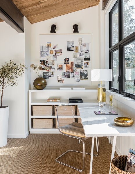 The second-floor mezzanine of this renovated home by Mowery Marsh Architects now hosts a spacious home office that looks out onto the roof terrace. A design departure from the photo above, this bright, airy space is full of home office ideas for her. It's feminine-chic with just-right touches of gold and natural materials.