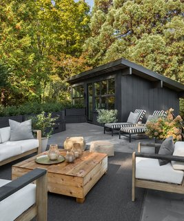 The roof terrace offers an outdoor lounge space, as well as views into the Seattle hills.