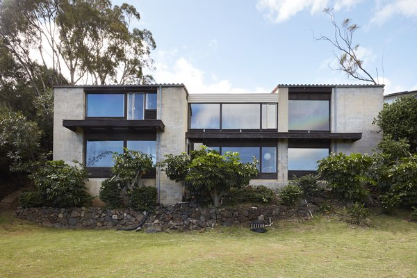 A back view of the house reveals its glass facade and perch on the hillside overlooking East Honolulu.