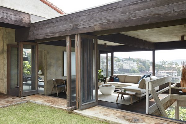 Folding doors make it easy for breezes to blow through the house and cool it naturally.