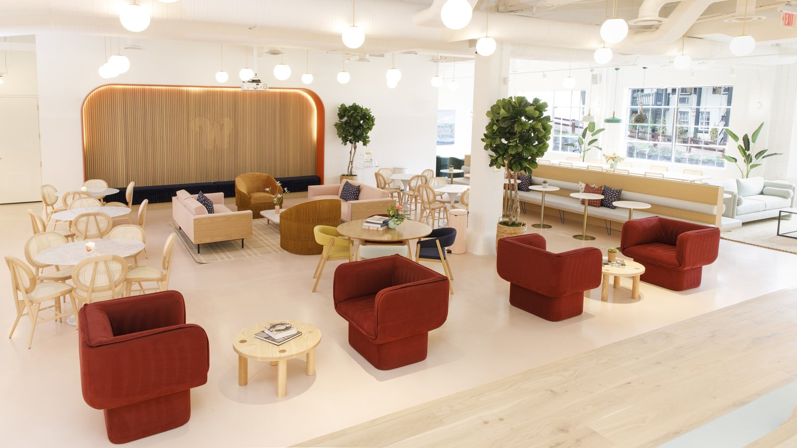 Office, Desk, Study Room Type, Chair, Lamps, and Light Hardwood Floor Deep red upholstered chairs from Missana are offset by a blush background in the common room.  Photo 6 of 13 in Feast Your Eyes on Washington D.C.'s Newest Co-Working Space For Women