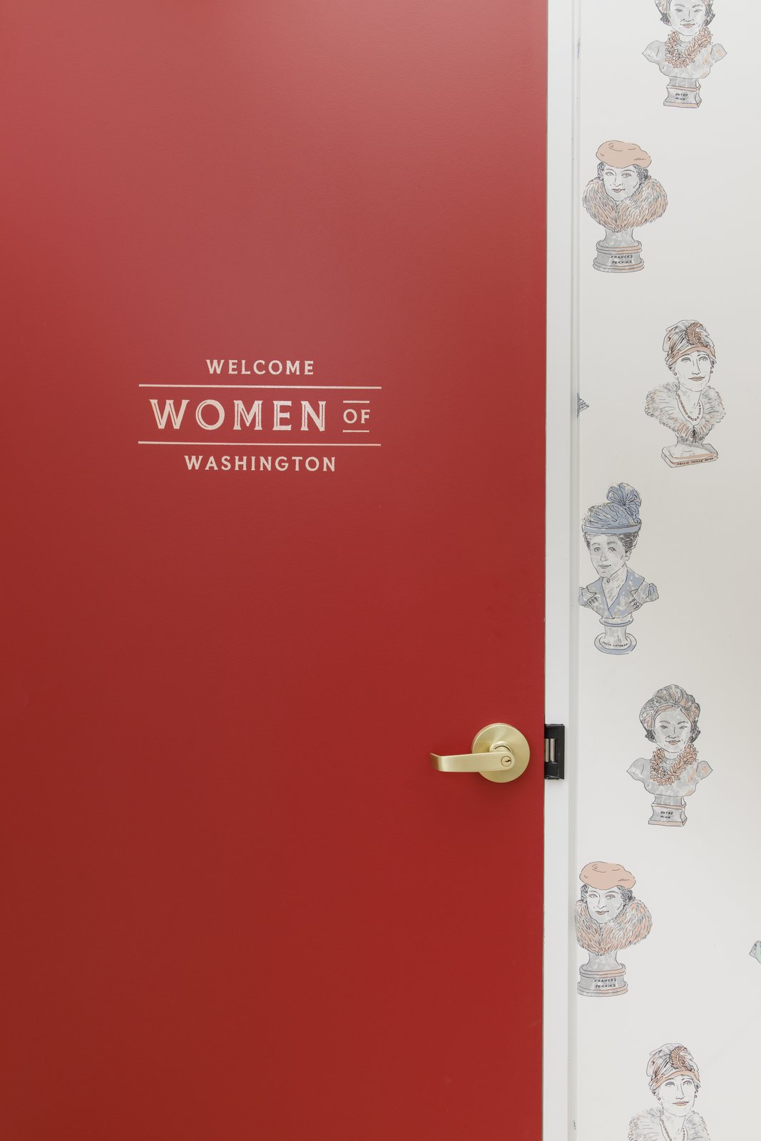 Doors, Wood, Interior, and Swing Door Type A red door at the entry welcomes members.  Photo 2 of 13 in Feast Your Eyes on Washington D.C.'s Newest Co-Working Space For Women