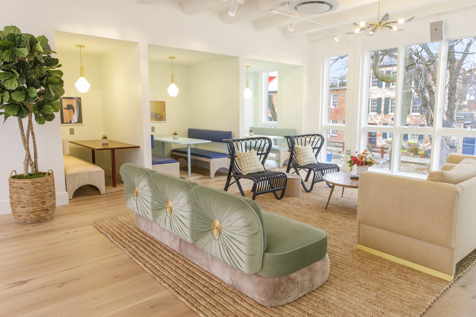 Office, Light Hardwood Floor, Rug Floor, Study Room Type, Desk, and Chair A mint couch from Cristina Celestino complements rattan chairs from 1st Dibs and the Cedar & Moss pendants over the booths.  Photo 10 of 13 in Feast Your Eyes on Washington D.C.'s Newest Co-Working Space For Women