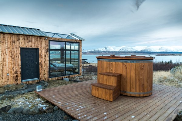 Another one of Panorama Glass Lodge Iceland's stargazing cabins is just a quick 30-minute drive from Reykjavík at Hvalfjörður (Whale Fjord). The glass-encased vacation rental includes a hot tub, so you can take your stargazing outside.