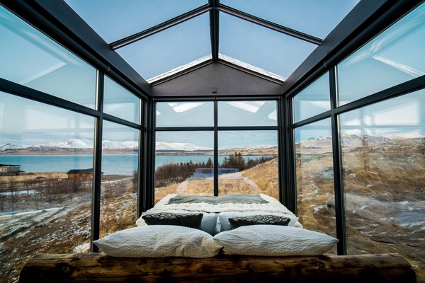 The custom-made king-sized bed is dressed with luxury duvets from Böhmerwald, Bavaria, and fluffy linen from Schlafgut, Germany. There are window blinds for the walls if more privacy is needed, while the glass roof remains exposed to the sky.