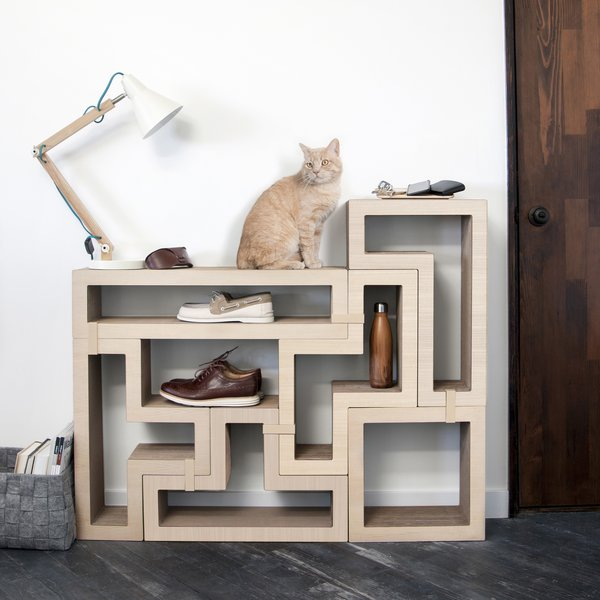 The modular cat tree from KATRIS includes a set of five blocks (each a different shape) and 10 clips for securing the blocks together. The beauty of the KATRIS approach is the flexibility of the design: you combine the blocks to create whatever formation you can imagine, which keeps the cat from getting bored.