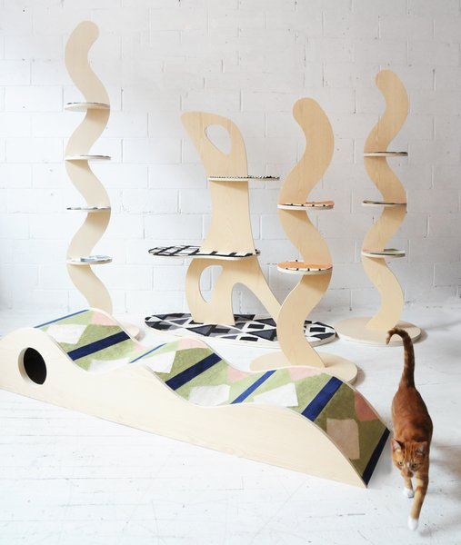 """According to Michael Yarinsky, the idea to design a line of attractive cat furniture came about while he and friend Aelfie Oudghiri were """"drinking a bit too much"""" and questioning why mainstream cat accessories were so ugly. Then and there, Yarinsky—an interdisciplinary designer who works in architecture, interiors, and furniture, and runs Brooklyn's Cooler Gallery—and Oudghiri, founder of the Aelfie rug and home goods company, decided to collaborate on their own cat furniture. """"The idea with the series was to fall somewhere between cat furniture and sculpture,"""" writes Yarinsky."""
